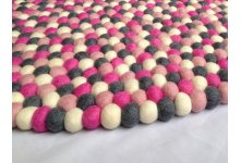 Gorgeous pink round felt ball rug