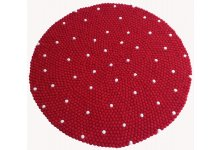 Red felt ball rug with white dotted